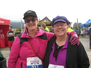 Our fabulous pink (me) and purple (Karen) fleece outfits before the 5K walk. Notice my first ever bib race number!