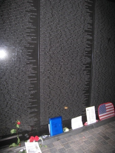 The Vietnam Wall at night on November 5, 2005, in Washington, D.C. The blue folder contains the War Stories I left there from my veteran writing students.